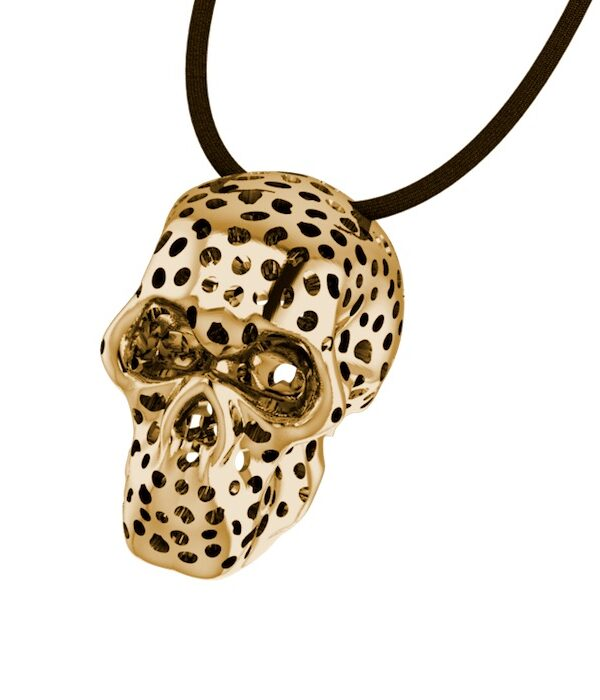 gold perforated skull