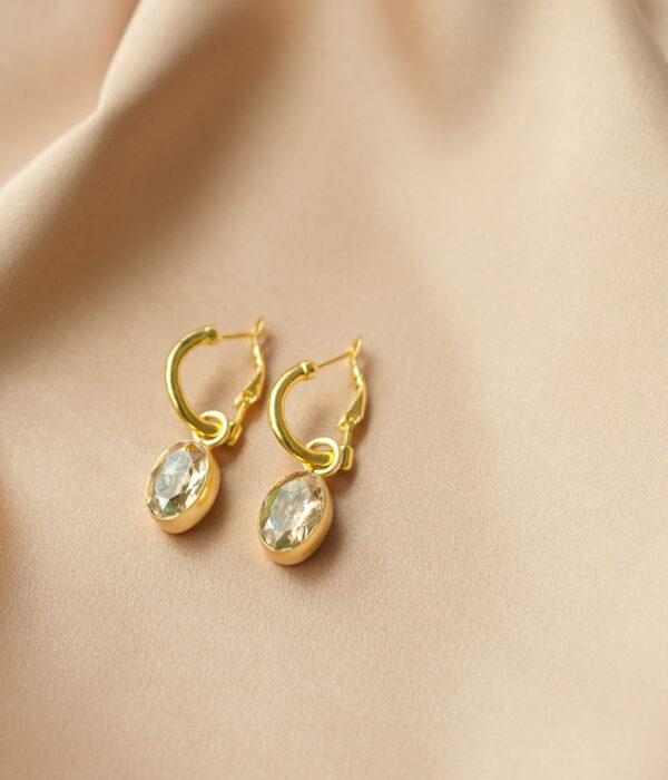 Gold sun earrings with swarovski stone